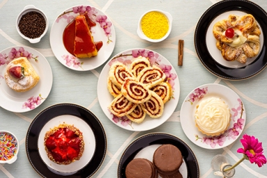 variety-of-baked-and-dessert-foods-on-plates-1448721
